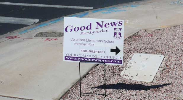One of the contested Good News Community Church street signs
