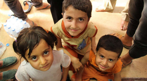 Iraqi refugee children being helped by aid group