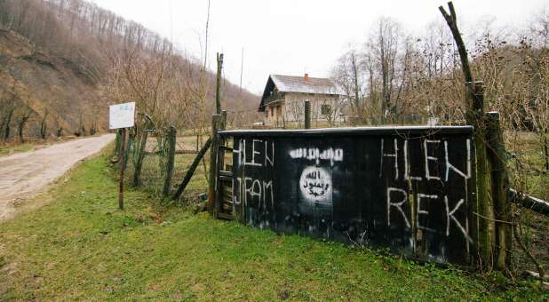 An entrance to the Bosnian village of Gornja Maoca decorated with Islamic State sign.