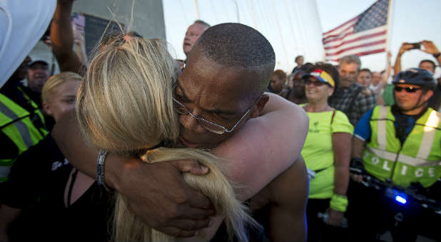 A man and woman hug outside Emanuel AME Church in Charleston. (Reuters)