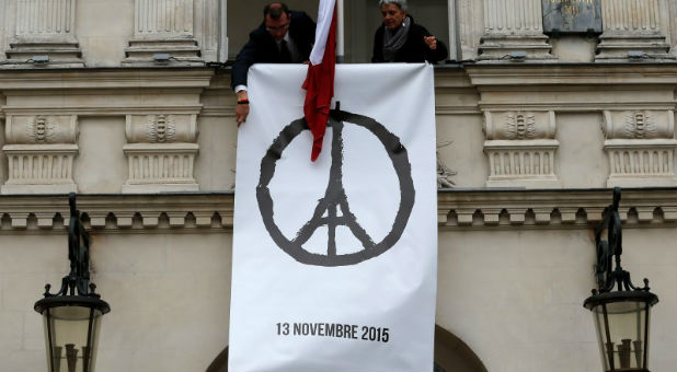 Parisians hang a peace banner after terrorist attacks rocked their city.