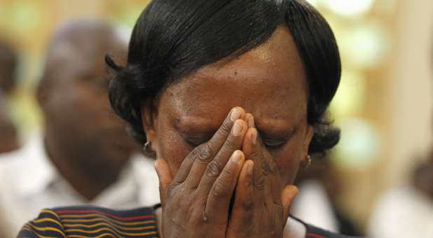A Kenyan woman mourns the terrorist attack on the university.