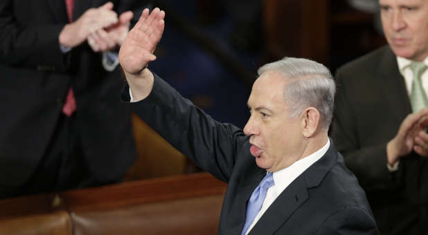 Israeli Prime Minister Benjamin Netanyahu waves prior to his address to a joint meeting of Congress in the House Chamber on Capitol Hill in Washington, March 3, 2015.