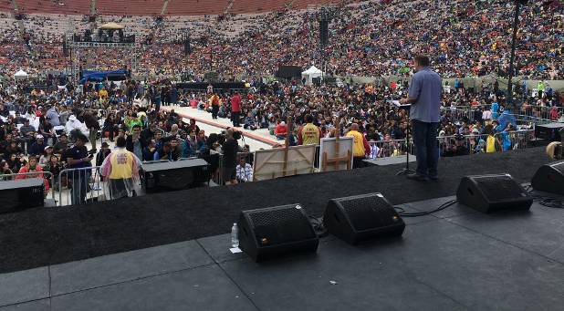 Jeff Jensen speaks to the crowd at Azusa Now at the Los Angeles Memorial Coliseum.
