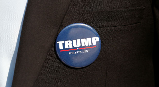 A member of the U.S. Republican party's election campaign team in Israel wears a badge of Republican U.S. presidential nominee Donald Trump during a campaign aimed at potential American voters living in Israel
