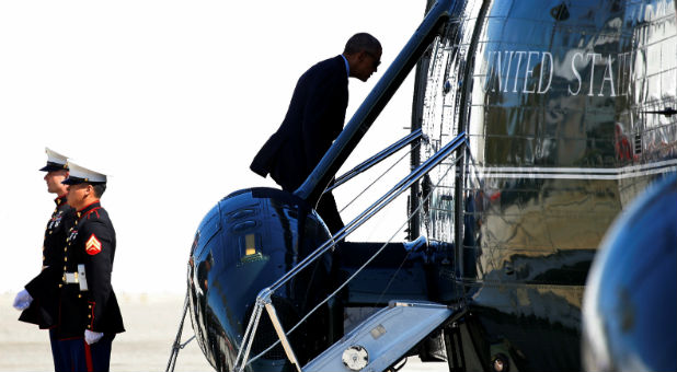 U.S. President Barack Obama boards Marine One to take him to Air Force One to depart Los Angeles and return to Washington