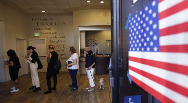 People stand in line to vote during the 2016 presidential election at the Anne Douglas Center at the Los Angeles Mission in Los Angeles
