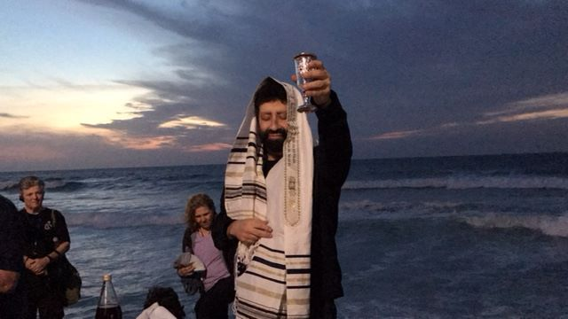 Jonathan Cahn opens his tour of Israel on the shores of Tel Aviv, Israel.