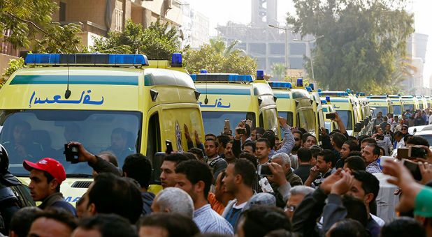 Egyptian Christians shout as ambulances transport the bodies of victims killed in the bombing of Cairo's main Coptic cathedral to the funeral, in Cairo, Egypt, on Dec. 12, 2016.
