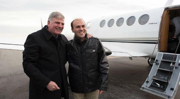 Franklin Graham greets Saeed Abedini after Abedini's release from prison.