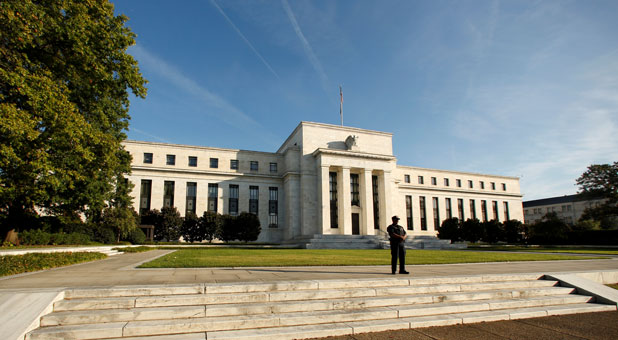 A police officer keeps watch in front of the U.S. Federal Reserve building in Washington, D.C.