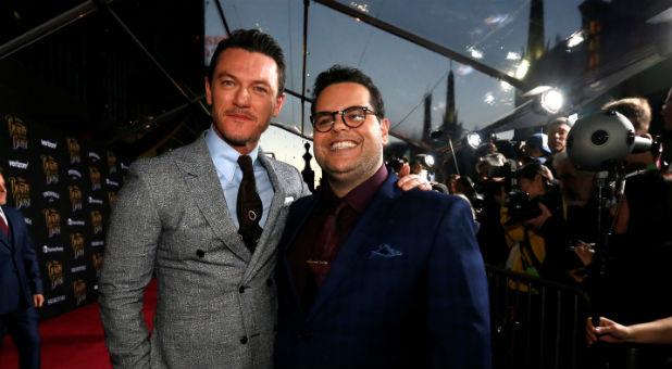 """Cast members Luke Evans (L) and Josh Gad pose at the premiere of """"Beauty and the Beast"""""""