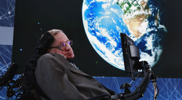 Physicist Stephen Hawking sits on stage during an announcement of the Breakthrough Starshot initiative