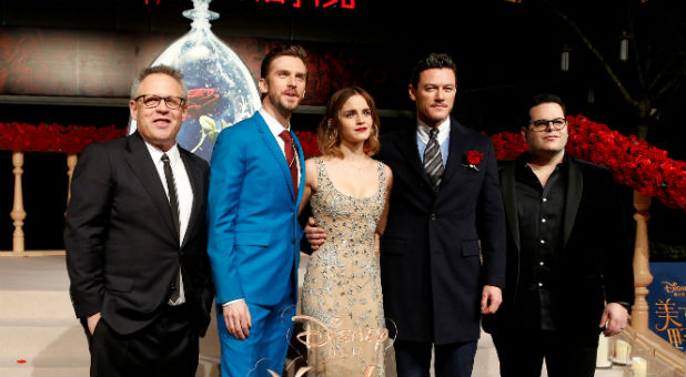 """Director Bill Condon and actors Dan Stevens, Emma Watson, Luke Evans, and Josh Gad (L-R) pose for photographers on the red carpet for the film """"Beauty and the Beast."""""""