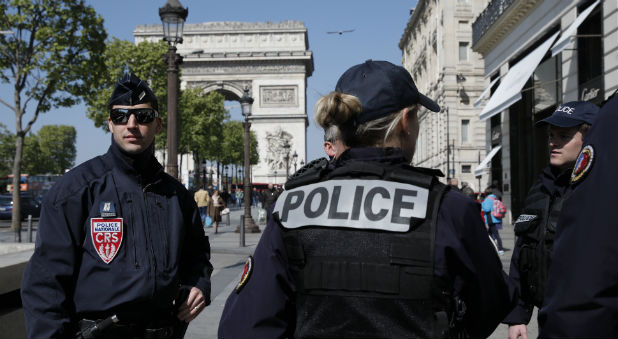 French CRS police patrol the Champs Elysees Avenue the day after a policeman was killed and two others were wounded in a shooting incident in Paris, France