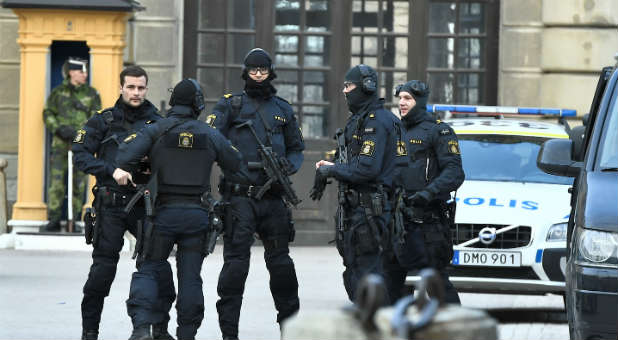 Policemen are seen outside Stockholm Castle after several people were killed and injured after a truck crashed into a department store Ahlens in central Stockholm, Sweden.