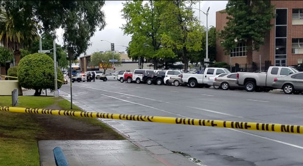 A road is blocked by police tape after a shooting incident in downtown Fresno, California.