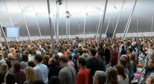 This tent revival in Burlington, North Carolina, is experiencing the power of the Holy Spirit.