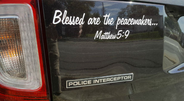 """Their attorney told them """"the decals would be a violation of the First Amendment based on the current case law because of the reference to Matthew 5:9."""""""