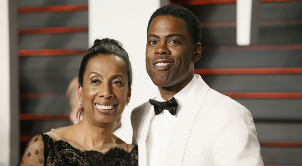 Actor Chris Rock and his mother, Rosalie Rock, arrive at the Vanity Fair Oscar Party.