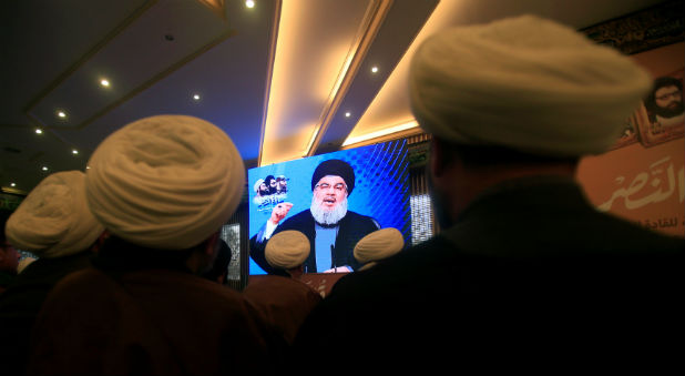 Lebanon's Hezbollah leader Sayyed Hassan Nasrallah addresses his supporters through a screen during a rally commemorating the annual Hezbollah Martyrs' Leaders Day in Jebshit village, southern Lebanon.