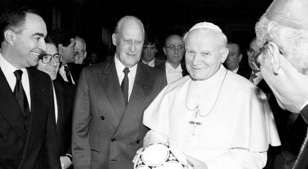 Pope John Paul II holds a ball to be used in the World Cup Soccer opening game as FIFA President Joao Havelange looks on in Rome December 9, 1989.