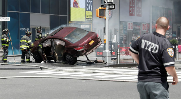 A vehicle that struck pedestrians and later crashed is seen on the sidewalk in Times Square in New York City.