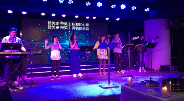 """Chinese believers worship in a """"house church."""""""