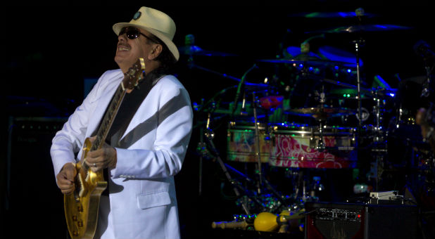 Rock 'n' roll legend Carlos Santana performs at a music festival.