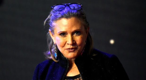 "Carrie Fisher poses for cameras as she arrives at the European Premiere of ""Star Wars: The Force Awakens"" in Leicester Square, London, Dec. 16, 2015."