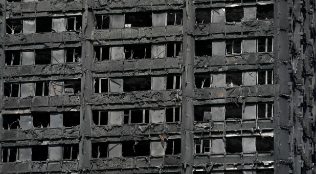 Extensive damage is seen to the Grenfell Tower block, which was destroyed in a fire disaster, in north Kensington, West London.
