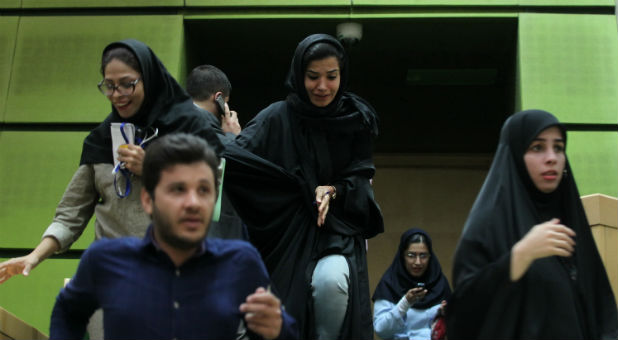Women are seen inside the Parliament during an attack in central Tehran, Iran.