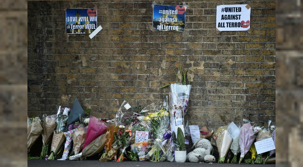 Messages and tributes are left near the site where a van was driven at Muslims in Finsbury Park, North London.