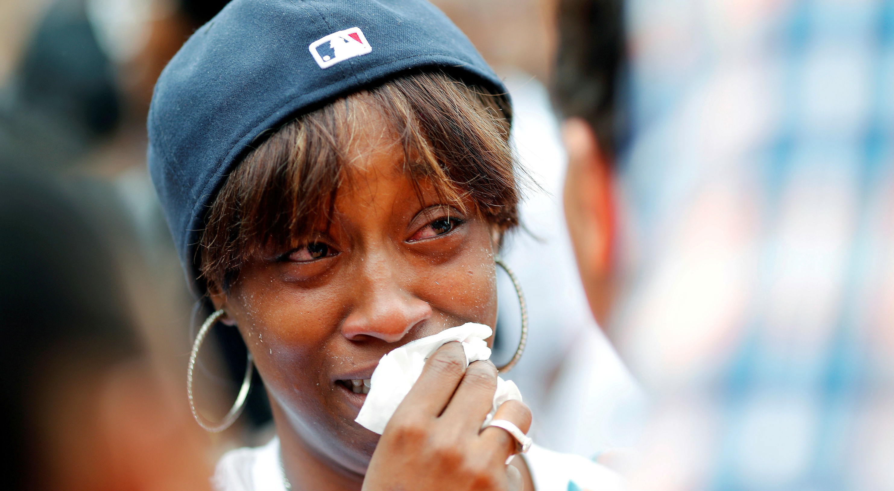 Diamond Reynolds, girlfriend of Philando Castile, weeps as people gather to protest the fatal shooting of Castile by Minneapolis area police during a traffic stop on Wednesday, in St. Paul, Minnesota, on July 7, 2016.