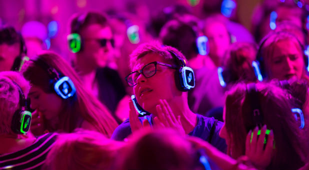 Festivalgoers dance at the silent disco stage during Open'er music Festival in Gdynia, Poland.