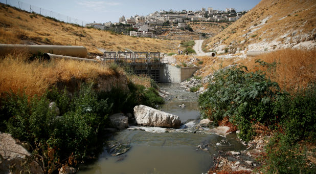 Sewage flows in Kidron Valley, on the outskirts of Jerusalem, July 6, 2017.