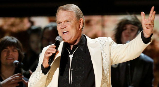 """Glen Campbell sings """"Rhinestone Cowboy"""" during his tribute at the 54th annual Grammy Awards in Los Angeles, California."""