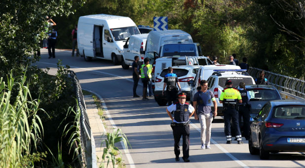 Catalan Mossos d'Escuadra vans are parked along a road near the place where Younes Abouyaaqoub, the man suspected of driving the van that killed 13 people in Barcelona last week, was killed by police in Sant Sadurni d'Noia, Spain, Aug. 21, 2017.