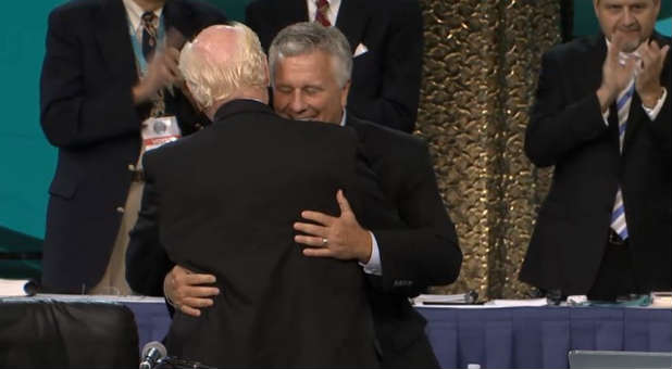 George O. Wood and Doug Clay embraced at the Assemblies of God General Council.