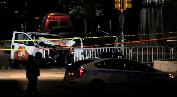 The pickup truck used in an attack on the West Side Highway sits behind police tape in Manhattan.