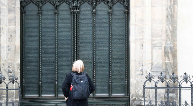 A woman looks at German theologian Martin Luther\u0027s theses door during the 500th Anniversary of the & How Martin Luther Gained the Faith for Supernatural Miracles ...