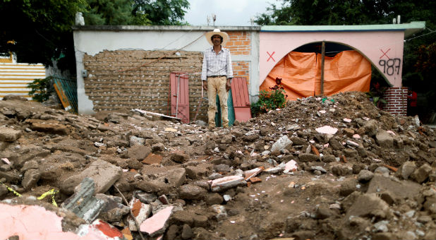 A man stands in the rubble after the Mexico earthquake.