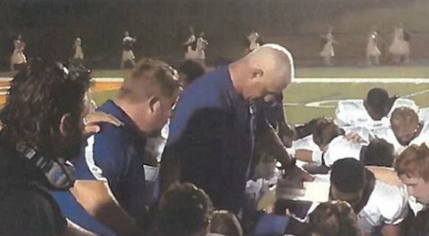 Heaven help the coach who bows his head to pray in Coweta County, Georgia.