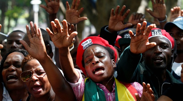 Protesters calling for Zimbabwean President Robert Mugabe to resign attend a prayer meeting outside parliament in Harare, Zimbabwe.