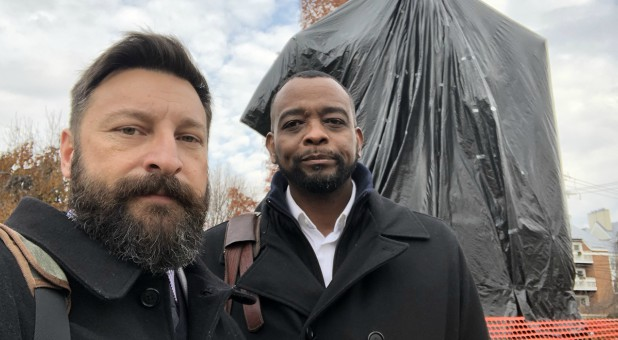 Matt Lockett and Will Ford in front of the covered Robert E. Lee statue.