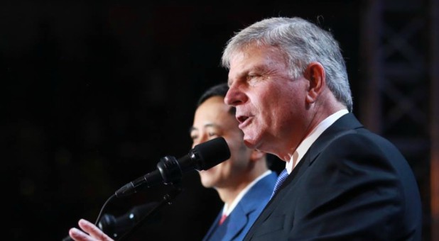 Franklin Graham speaks at a crusade.