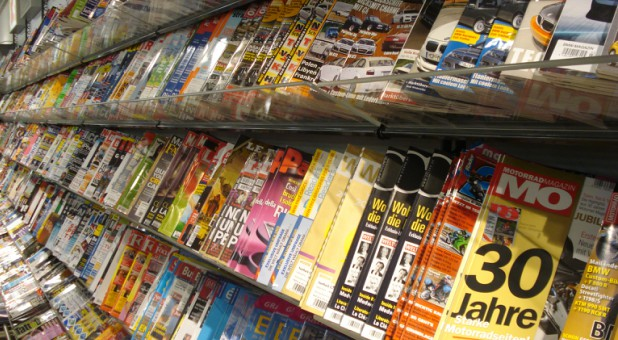 The super retailer is banning the Jezebelic magazine with lewd headlines and suggestive images from its checkout lines.