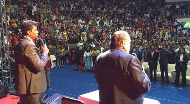 Morris Cerullo, right, preaches in India.