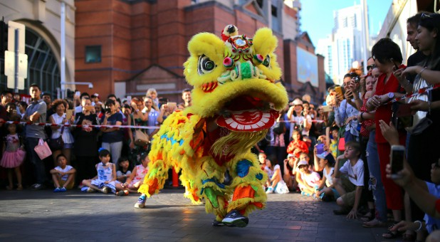 Performers dressed in costumes dance for spectators as part of celebrations for the Chinese Lunar New Year.