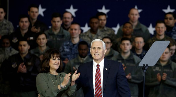 U.S. Vice President Mike Pence arrives with his wife, Karen.